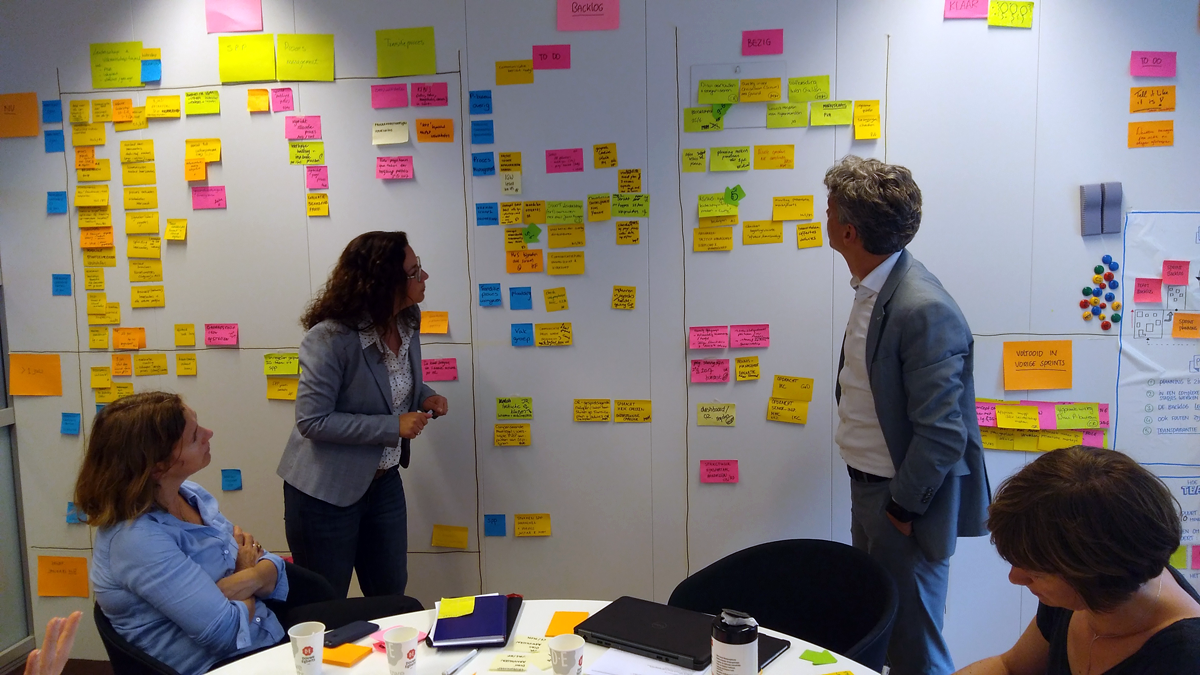 This team Scrum to guide an organizational redesign process. Although their work didn't fit entirely with Scrum, the team benefitted from the transparency and the collaboration made possible by Scrum.