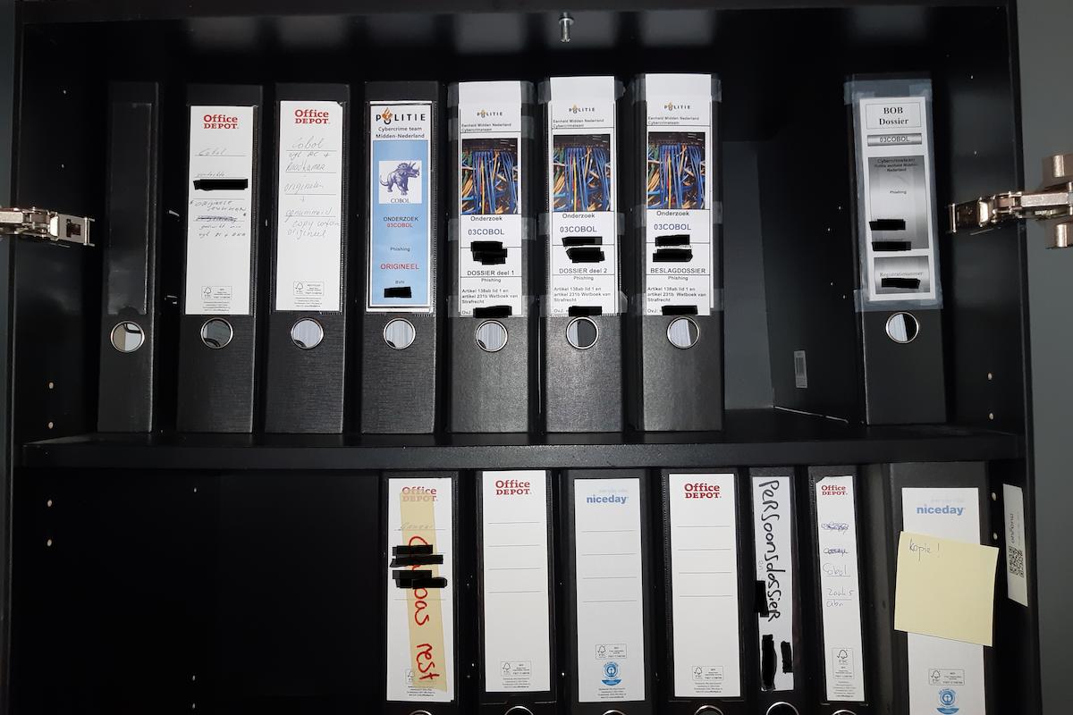 Police case file binders (redacted)